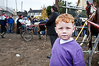 4/10/2010. A traveler boy watches the trotters at the Ballinasloe Horse Fair, Ballinasloe, Ireland. Picture James Horan