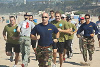 A team of Navy SEALs train winners from Omaze at Santa Monica beach on Saturday, August 18, 2012. Omaze is a Santa Monica based website that offers everybody the opportunity to engage in once-in-a-lifetime experiences that benefit charitable causes. www.omaze.com.