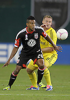 WASHINGTON, DC - OCTOBER 20, 2012:  Lionard Pajoy (26) of D.C United tangles with Chris Birchall (8) of the Columbus Crew during an MLS match at RFK Stadium in Washington D.C. on October 20. D.C United won 3-2.