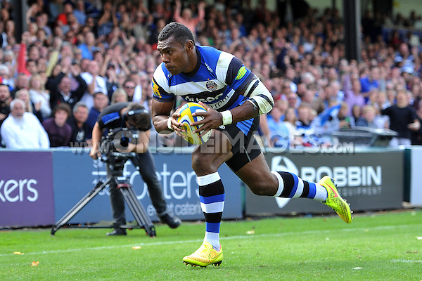 Semesa Rokoduguni runs in a try. Pre-season friendly match, between Bath Rugby and the Scarlets on August 16, 2014 at the Recreation Ground in Bath, England. Photo by: Patrick Khachfe / Onside Images