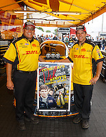 Aug 20, 2016; Brainerd, MN, USA; NHRA funny car driver Del Worsham (right) poses for a photo with his crew to commemorate the 500th start of his career during qualifying for the Lucas Oil Nationals at Brainerd International Raceway. Mandatory Credit: Mark J. Rebilas-USA TODAY Sports