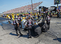Sep 5, 2016; Clermont, IN, USA; NHRA top fuel driver Antron Brown surrounded by crew members during the US Nationals at Lucas Oil Raceway. Mandatory Credit: Mark J. Rebilas-USA TODAY Sports