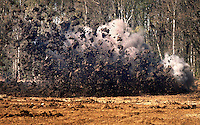 The Belgian Unexploded Ordnance Diposal Group destroy some live munitions in a controlled explosion. Farmers plough up so much live munitions that such controlled explosions take place twice every day.