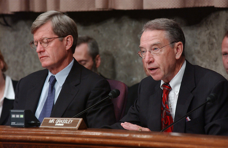 """10/21/03.TAX SHELTERS--Ranking Democrat Max Baucus, D-Mont., and Chairman Charles E. Grassley, R-Iowa,  during the Senate Finance Committee hearing on tax shelters titled """"Tax Shelters: Who's Buying, Who's Selling, and What's the Government Doing About It?"""" .CONGRESSIONAL QUARTERLY PHOTO BY SCOTT J. FERRELL"""