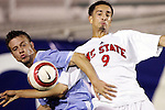 9 November 2005: North Carolina's Michael Harrington (left) struggles for the ball with North Carolina State's Bryant Salter (right). The University of North Carolina defeated North Carolina State University 1-0 at SAS Stadium in Cary, North Carolina in a quarterfinal of the 2005 ACC Men's Soccer Championship.