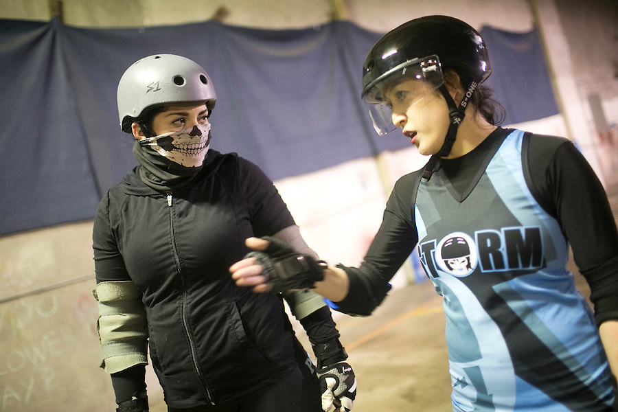 Storm City Roller Girls Darkness (L) and Trouble Axle (R) chat as they practice in Vancouver Thursday February 9, 2017. (Photo by Natalie Behring for the Columbian)