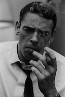 December 4th, 1965. Jacques Brel in his hotel room smoking a cigar.