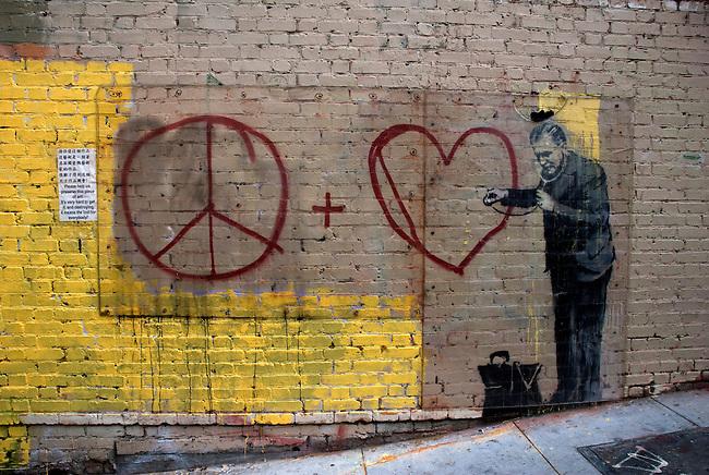 Peace + Heart graffiti on wal in San Franciscol
