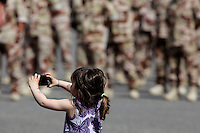 A girl takes a picture of her father and fellow soldiers. Norwegian soldiers receive medals after a tour with International Security Assistance Force (ISAF), Afghanistan. Prime Minister Jens Stoltenberg and Defense Minister Grete Faremo attended the ceremony held at Akershus Castle in Oslo.