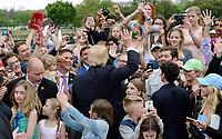 United States President Donald J. Trump greets attendees at the annual Easter Egg roll on the South Lawn of the White House in Washington, DC, on April 17, 2017. <br /> CAP/MPI/CNP/RS<br /> &copy;RS/CNP/MPI/Capital Pictures