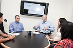 July 29, 2011. Cary, NC.. John Sall, the Executive VP of SAS, center, meets with colleagues in his office.. Profile of SAS, a software company that has many amenities for its employees.