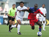 Mariano Acevedo (left) chases after Fabrice Noel (right). Honduras defeated Haiti 1-0 during the First Round of the 2009 CONCACAF Gold Cup at Qwest Field in Seattle, Washington on July 4, 2009.