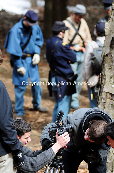 THOMASTON, CT, 16 MAR 13- 031613AJ03- Logan Fulton, of Redding, left, adjusts a camera while Civil War re-enactors from New York, Rhode Island and Connecticut await orders in the background during a movie shoot in Thomaston on Saturday.  Alec Johnson/ Republican-American