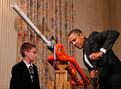 United States President Barack Obama pumps an Extreme Marshmallow Cannon invented by fourteen year old Joey Hudy (L) from Phoenix, Arizona, while touring student science fair projects on exhibt in the State Dining Room at the White House in Washington, D.C. on February 7, 2012. Obama hosted the second White House Science Fair celebrating the student winners of science, technology, engineering and math (STEM) competitions from across the country. Credit: Molly Riley / Pool via CNP