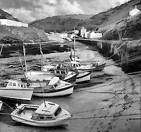 Monochrome painterly effect on photograph of Boscastle Harbour, Cornwall, UK.