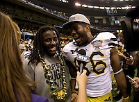 Michigan quarterback Denard Robinson and Michigan tight end Kevin Koger talk with the reporter after winning Sugar Bowl game against Virginia Tech at Mercedes-Benz SuperDome in New Orleans, Louisiana on January 3rd, 2012.  Michigan defeated Virginia Tech, 23-20 in first overtime.