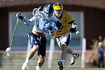 06 February 2016: North Carolina's Evan Connell (99) and Michigan's Dan Kinek (9). The University of North Carolina Tar Heels hosted the University of Michigan Wolverines in a 2016 NCAA Division I Men's Lacrosse match. UNC won the game 20-10.