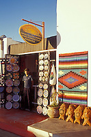 Boy standing in front of a Mexican handicrafts shop in the Spanish colonial town of Todos Santos , Baja California Sur, Mexico