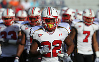 Nov 13, 2010; Charlottesville, VA, USA; Maryland Terrapins defensive back Cameron Chism (22) takes the field with teammates before the game against the Virginia Cavaliers at Scott Stadium.  Mandatory Credit: Andrew Shurtleff-US PRESSWIRE-US Presswire
