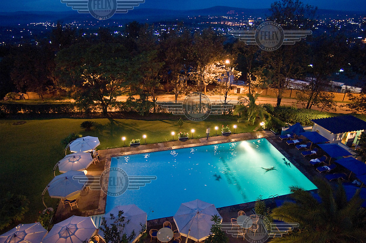 """Swimming pool of Hotel Des Mille Collines. The Hotel des Mille Collines became famous as the building in which more than a thousand people took refuge during the Rwandan Genocide of 1994. The story of the hotel and its manager at that time, Paul Rusesabagina, was used as the basis of the movie Hotel Rwanda. The French, """"des Mille Collines"""", is from """"Land of a Thousand Hills"""", a poetic name for Rwanda.."""