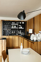 The kitchen has been designed so that all shelves and appliances can be hidden behind sliding cupboard doors
