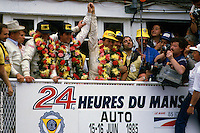 Klaus Ludwig, Paolo Barilla and John Winter celebrate victory in the 1985 24 Hours of Le Mans race in Le Mans, France.