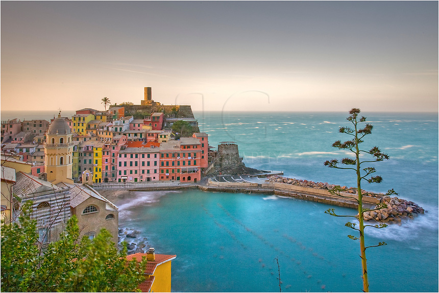 Vernazza, Italy, is part of the Cinque Terre on the Ligurian Coast of Italy. It is a lovely small fishing village with pastel colored homes.
