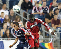 New England Revolution midfielder Diego Fagundez (14) and Chicago Fire defender Jalil Anibaba (6) battle for head ball.  In a Major League Soccer (MLS) match, the New England Revolution (blue) defeated Chicago Fire (red), 2-0, at Gillette Stadium on August 17, 2013.