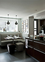This contemporary kitchen has the benefit of an L-shaped breakfast area with a banquette built under the window