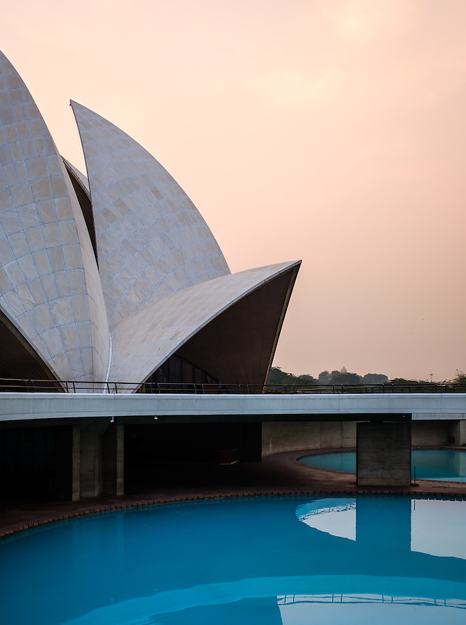 """NEW DELHI, INDIA - CIRCA OCTOBER 2016: The Lotus Temple in Delhi, also known as the  Bahai House of Worship. This is a popular tourist attraction in Delhi. The building is composed of 27 free-standing marble-clad """"petals"""" arranged in clusters of three to form nine sides, with nine doors opening."""