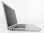 Apple Macbook Pro laptop computer side view isolated on white background