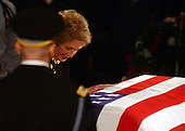 Washington, D.C. - June 9, 2004 -- Former first lady Nancy Reagan sheds a tear over the casket of her husband, former United States President Ronald Reagan in the rotunda of the United States Capitol in Washington, D.C. on June 9, 2004.<br /> Credit: Ron Sachs / CNP