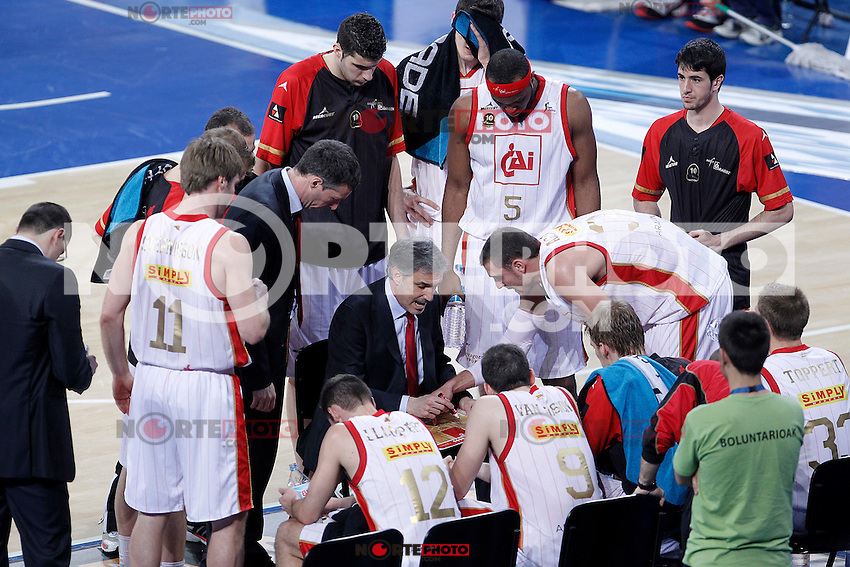 CAI Zaragoza's coach Jose Luis Abos with Pablo Aguilar in time out during Spanish Basketball King's Cup match.February 07,2013. (ALTERPHOTOS/Acero)