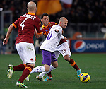 Calcio, Serie A: Roma vs Fiorentina. Roma, stadio Olimpico, 8 dicembre 2012..Fiorentina midfielder Borja Valero, of Spain, right, is challenged by AS Roma defender Ivan Piris, of Paraguay, and midfielder Michael Bradley, of the United States, left, during the Italian Serie A football match between AS Roma and Fiorentina at Rome's Olympic stadium, 8 december 2012..UPDATE IMAGES PRESS/Isabella Bonotto