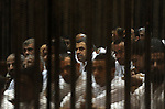 Muslim Brotherhood members sit behind the defendants cage as they attend their trial, at a court in the outskirts of Cairo, Egypt, Dec. 07, 2015. Photo by Amr Sayed