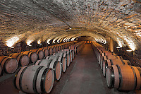 Medieval wine cellar, 300m long, with storage for barrels of wine, below the 19th century storage rooms built on earlier rooms of 1645, in Les Hospices de Beaune, or Hotel-Dieu de Beaune, a charitable almshouse and hospital for the poor, built 1443-57 by Flemish architect Jacques Wiscrer, and founded by Nicolas Rolin, chancellor of Burgundy, and his wife Guigone de Salins, in Beaune, Cote d'Or, Burgundy, France. This was the venue for the famous annual wine auction  1926-58. The hospital was run by the nuns of the order of Les Soeurs Hospitalieres de Beaune, and remained a hospital until the 1970s. The building now houses the Musee de l'Histoire de la Medecine, or Museum of the History of Medicine, and is listed as a historic monument. Picture by Manuel Cohen