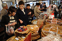Buying miso and miso products as souvenirs in the factory shop, Ishii Miso, Matsumoto, Japan, May 19, 2009. The miso company, founded in 1868, uses Japanese soy beans and wooden barrels to make premium miso aged for up to three years.