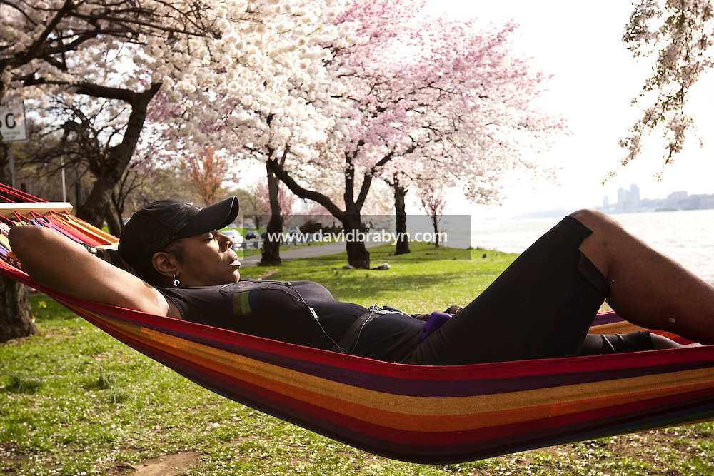 Maria David lies in a hammock drawn between two trees in Riverside Park between the Hudson River and the Henry Hudson Parkway in New York, NY, USA, 7 April 2010, as temperatures reach an unseasonal 84 degree Farenheit.