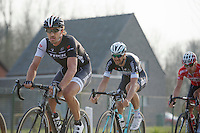 Tom Boonen (BEL/OPQS) in  Fabian Cancellara's (CHE/TrekFactoryRacing) wheel on the cobbled Varentstraat with 7km to go<br /> <br /> 57th E3 Harelbeke 2014