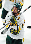 12 December 2009: University of Vermont Catamount forward and team co-captain Brian Roloff (14), a Senior from West Seneca, NY, returns to the bench after scoring his second goal against the St. Lawrence University Saints at Gutterson Fieldhouse in Burlington, Vermont. The Catamounts shut out their former ECAC rival Saints 3-0. Mandatory Credit: Ed Wolfstein Photo