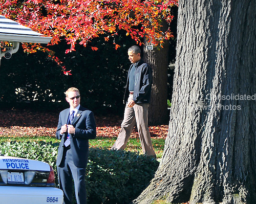 United States President Barack Obama walks to his limo as he departs the White House in Washington, D.C. to play golf at Joint Base Andrews on Friday, November 25, 2011..Credit: Ron Sachs / Pool via CNP