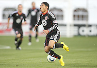 Cristian Castillo #12 of D.C. United reacts to a hard tackle during a US Open Cup match against F.C. Dallas on April 28 2010, at RFK Stadium in Washington D.C. United won 4-2.
