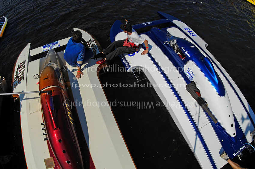 """Kent Henderson, S-00 """"Bank On It""""  and John Shaw, S-816  talk at the dock.  (2.5 Litre Stock hydroplane(s)"""