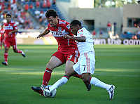 Chicago defender Dan Gargan (3) blocks a shot by Toronto forward Joao Plata (7).  The Chicago Fire defeated Toronto FC 2-0 at Toyota Park in Bridgeview, IL on August 21, 2011.