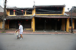A man walks his son along the empty streets one early morning in the old Japanese quarter of Hoi An, Vietnam. The city was an important colonial trading port from the 15th to the 19th centuries, and traders from Japan, China, and Europe all lived here. The architecture of Hoi An Ancient Town is the most well-preserved in Vietnam. April 22, 2012.
