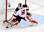 9 January 2010: New Jersey Devils' goaltender Martin Brodeur makes a first period save against the Montreal Canadiens at the Bell Centre in Montreal, Quebec, Canada. The Devils edged out the Canadiens 2-1 in overtime. Mandatory Credit: Ed Wolfstein Photo