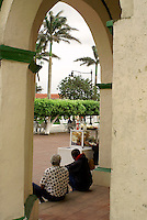 Men sitting under a colonnade in the Spanish colonial town of Tlacotalpan,  Veracruz, Mexico. Tlacotalpan is a UNESCO World Heritage Site.              .