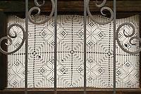 White lace window curtain, San Miguel de Allende, Mexico. San Miguel de Allende is a UNESCO World Heritage Site.