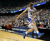 Mason Plumlee throws the ball back into play in the second half.Lehigh defeated Duke 75-70 during the 2nd round of the 2012 NCAA Basketball Championship at the Greensboro Coliseum in Greensboro, NC. Photo by Al Drago.