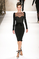 Carola walks runway in a Monique Lhuillier Fall 2011 outfit, during Mercedes-Benz Fashion Week Fall 2011.